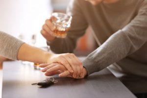 Woman preventing drunk man from taking car keys