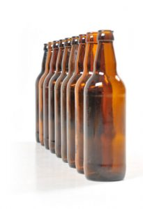 a row of empty beer bottles