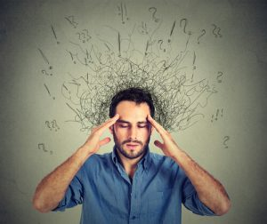 stressed nervous man holding his head