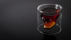 skull-shaped shot of whiskey as a sybmol of death