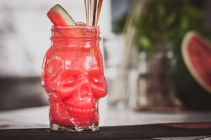 skull-shaped glass with alcohol