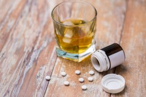 glass of whisky and barbiturate pills