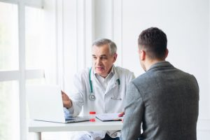 senior doctor consulting the patient