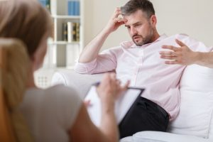 man on individual therapy session
